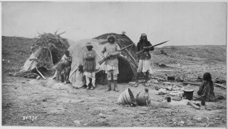Apache rancheria with two men holding rifles - Picture and Text Courtesy of : Casita De Gila Southwestern Guesthouses on 265 Acres near Silver City, New Mexico overlooking Bear Creek and the Gila Wilderness..................