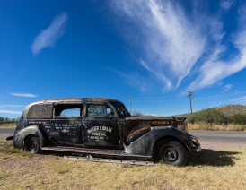 A Packard hearse beside the road at Boot Hill Tombstone