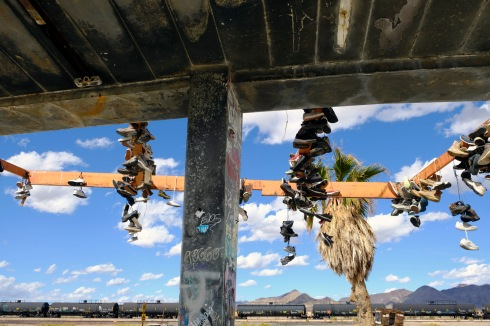 Hanging shoes and railway wagons in the Mohave desert.