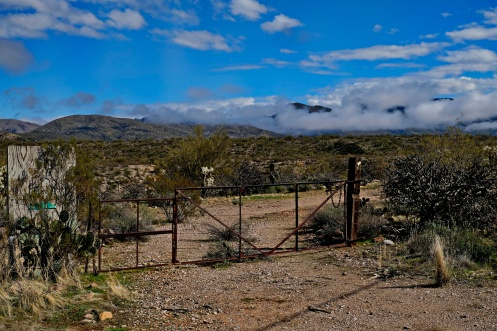 Old and deserted land with gates going seemingly going nowhere